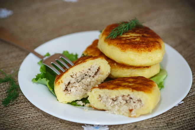 Potato cakes with meat on the plate